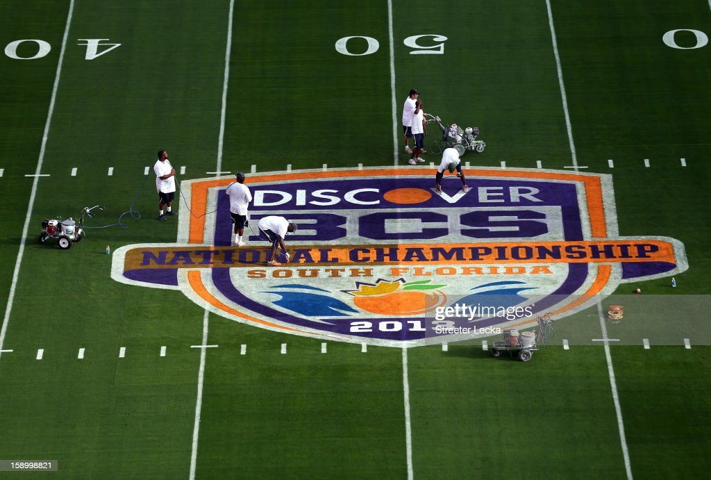 The field logo is painted by workers during Media Day ahead of the Discover BCS National Championship at Sun Life Stadium on January 5, 2013 in Miami Gardens, Florida.