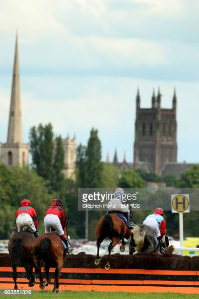 The field make their way around the course during the coralcouk Conditional Jockeys' Handicap Hurdle Race at Worcester Racecourse with Worcester...