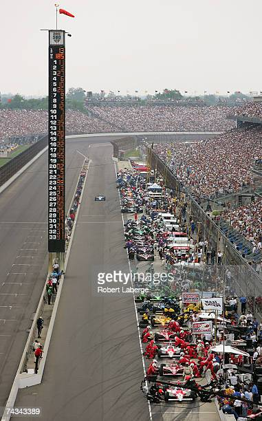 The field of cars make a pit stop under caution during the IRL IndyCar Series 91st running of the Indianapolis 500 at the Indianapolis Motor Speedway...