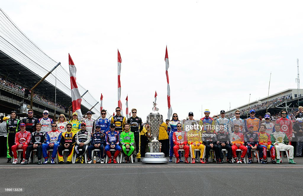 The field of drivers pose for a group photo on the grid during the IZOD IndyCar Series 97th running of the Indianpolis 500 mile race at the Indianapolis Motor Speedway on May 26, 2013 in Indianapolis, Indiana.