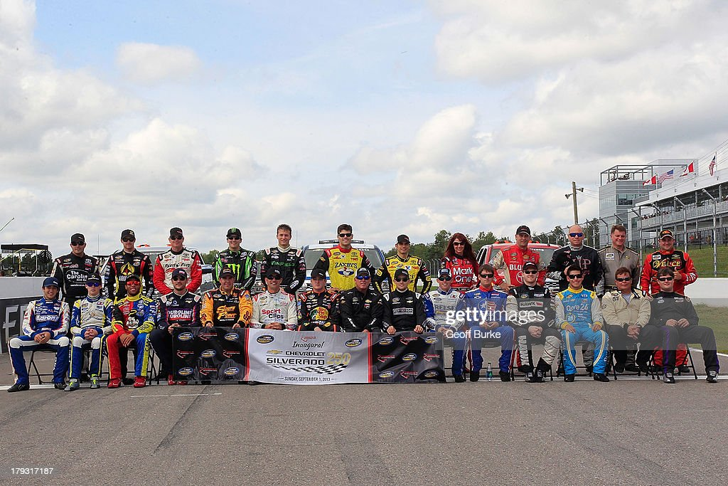 The field of drivers pose for a picture at the start/finish line prior to the NASCAR Camping World Truck Series Chevrolet Silverado 250 at Canadian Tire Motorsport Park on September 1, 2013 in Bowmanville, Canada.