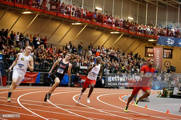 The field of the Men's 4x400 meet relay turns the corner in front of a capacity crowd at the Division III Men's and Women's Indoor Track and Field...