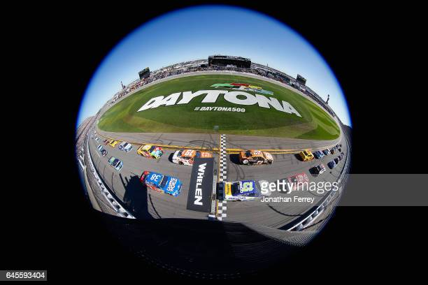 The field passes the green flag at the start of the 59th Annual DAYTONA 500 at Daytona International Speedway on February 26 2017 in Daytona Beach...