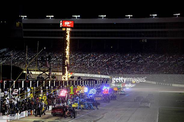 The field pits during the NASCAR Sprint Cup Series Duck Commander 500 at Texas Motor Speedway on April 11 2015 in Fort Worth Texas