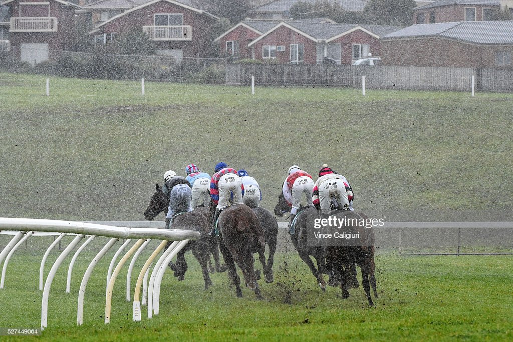 The field race into the home straight in driving rain in Race 2, the TAB.Com.au Maiden Hurdle during Brierly Day at Warrnambool Race Club on May 3, 2016 in Warrnambool, Australia.