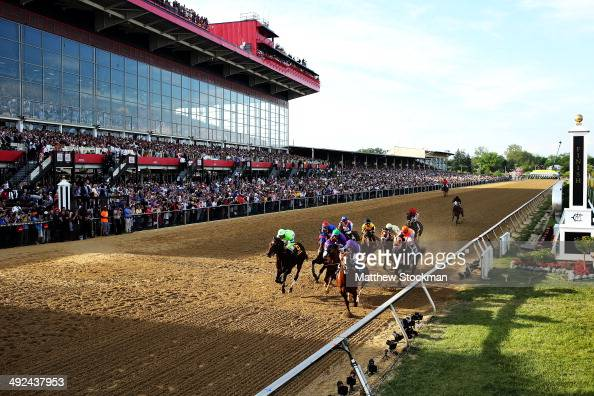 The field races into the first turn during the 139th running of the Preakness Stakes at Pimlico Race Course on May 17 2014 in Baltimore Maryland