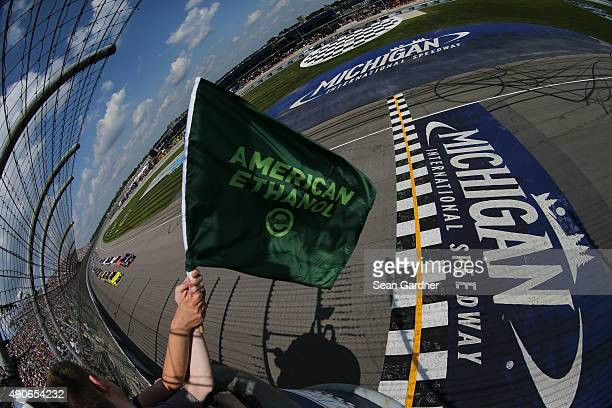 The field takes the green flag during the NASCAR Sprint Cup Series Pure Michigan 400 at Michigan International Speedway on August 16 2015 in Brooklyn...
