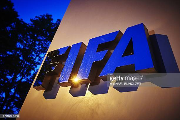 The FIFA logo is pictured at the FIFA headquarters on June 2 2015 in Zurich Blatter on June 2 2015 resigned as president of FIFA as a mounting...