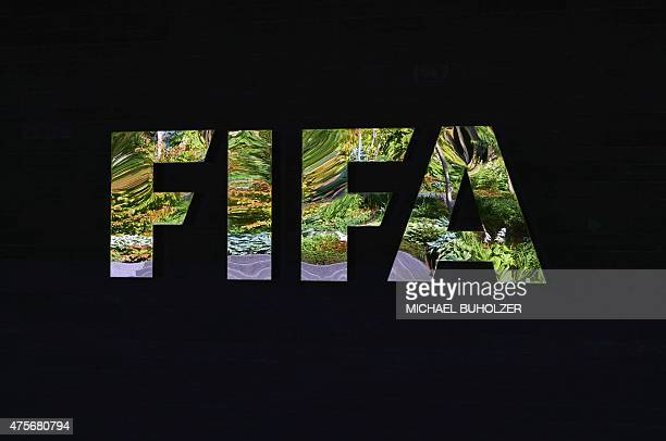 The FIFA logo made with mirrors is pictured at the FIFA headquarters on June 3 2015 in Zurich Blatter on June 2 2015 resigned as president of FIFA as...