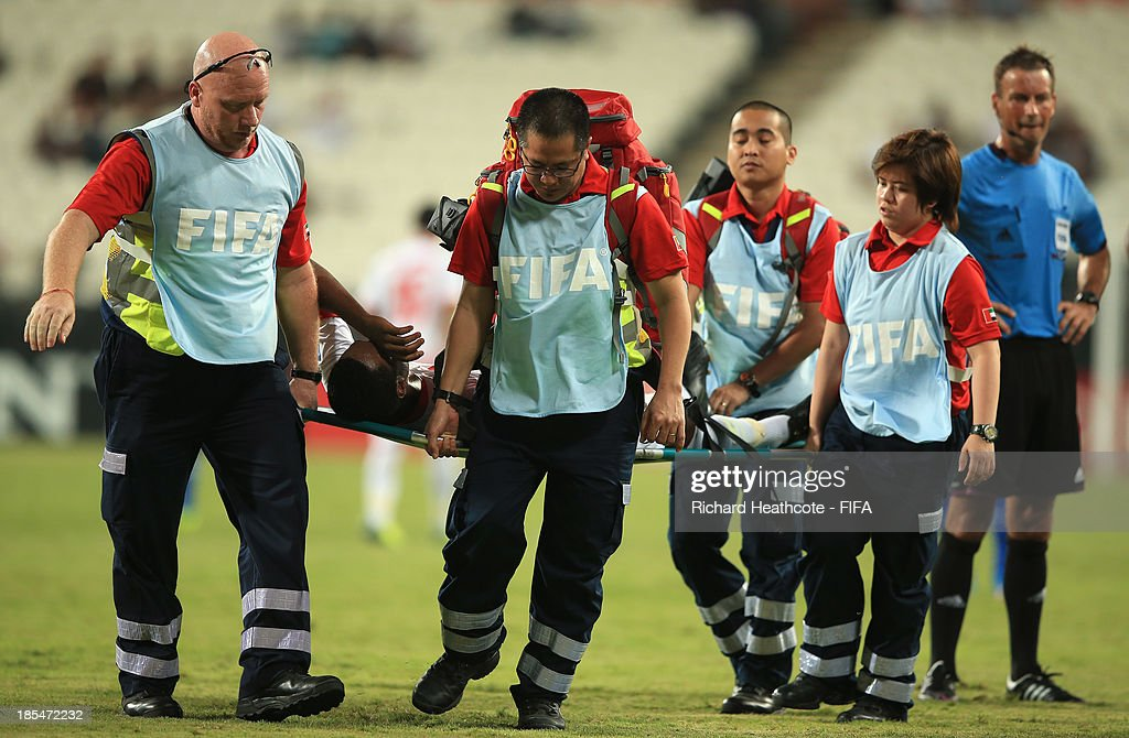 The FIFA medical staff remove a player from the pitch on a stretcher during the FIFA U-17 World Cup UAE 2013 Group A match between United Arab Emirates and Brazil at the Mohamed Bin Zayed Stadium on October 20, 2013 in Abu Dhabi, United Arab Emirates.