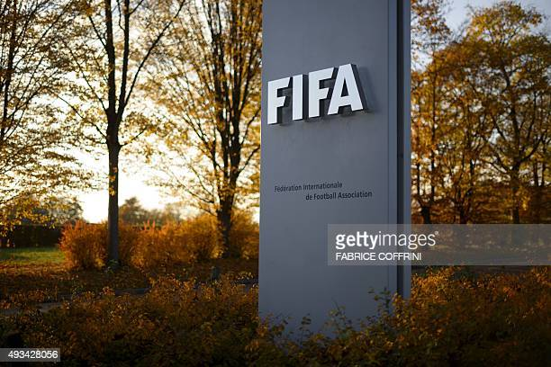 The FIFA sign is seen at the entrance of world football's governing body headquarters in Zurich on October 20 2015 FIFA's reform committee on October...