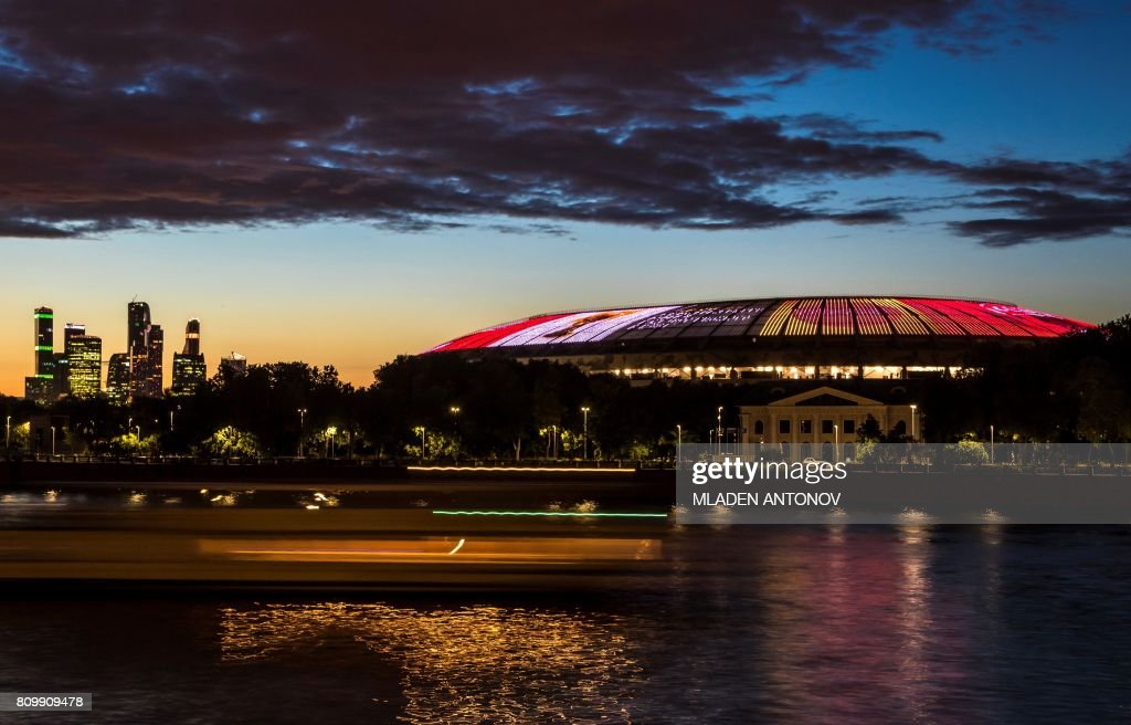 The FIFA World Cup Trophy is projected on the roof of the Luzhniki Olympic stadium, marking the FIFA World Cup Trophy Tour Route announcement on July 6, 2017 in Moscow. The opening and final matches of the FIFA World Cup 2018 will be played on the field of Luzhniki stadium. / AFP PHOTO / Mladen ANTONOV