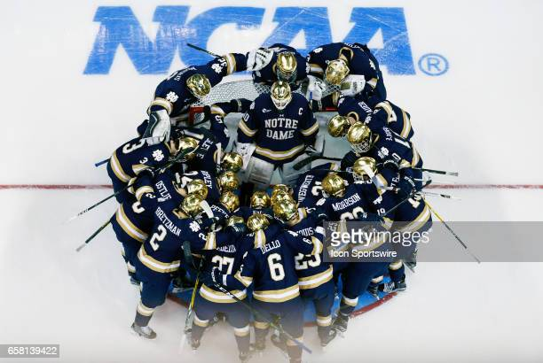The Fighting Irish gather around Notre Dame Fighting Irish goaltender Cal Petersen before the start of the NCAA Northeast Regional final between the...
