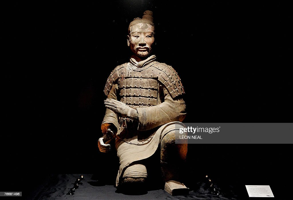 The figure of a kneeling archer is displayed at an exhibition entitled 'The First Emperor: China's Terracotta Army' at the British Museum, in central London, 12 September 2007. China's terracotta army is set to invade Britain on Thursday as some of the famous warriors go on show in London in a highly-anticipated exhibition. The British Museum is hosting 'The First Emperor: China's Terracotta Army' until April 6 and advance ticket sales are already breaking box office records, according to The Times newspaper. About a dozen warriors are set to go on show. Around 100,000 tickets have already been sold and the exhibition could outstrip the Treasures of Tutenkhamun display in 1972, seen by 1.7 million people. AFP PHOTO/Leon Neal