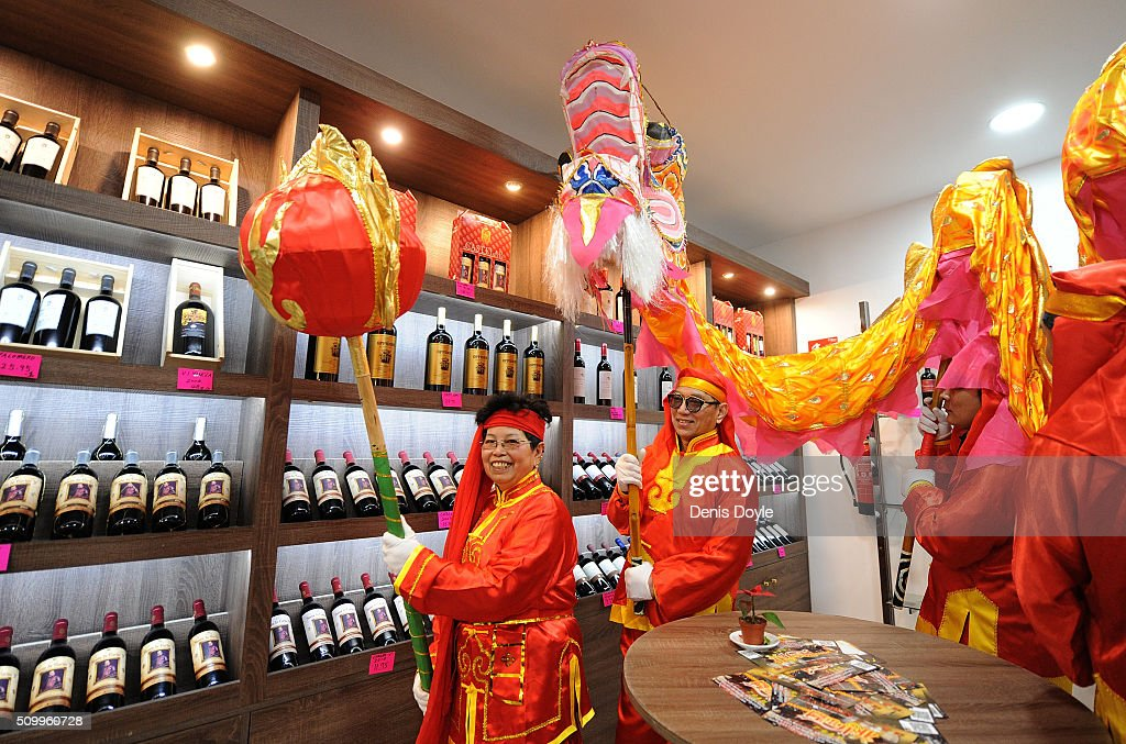 The figure of the dragon visits a wine store to give good luck for the lunar new year during the procession to celebrate The Year of The Monkey on February 13, 2016 in Madrid, Spain. The Madrid Town Hall has organised this year's Chinese New Year for the first time in Madrid's Chinatown district of Usera.