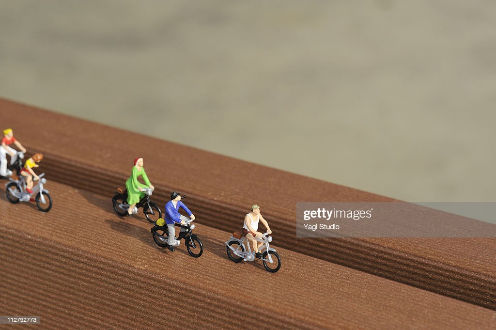 The figure of the person who rides on the bicycle : Stock Photo