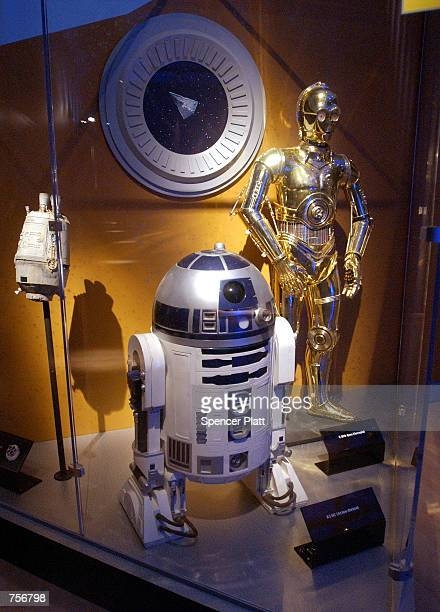 The figures of R2D2 and C3PO stand on display April 4 2002 at the exhibit 'Star Wars The Magic of the Myth' at the Brooklyn Museum of Art in Brooklyn...