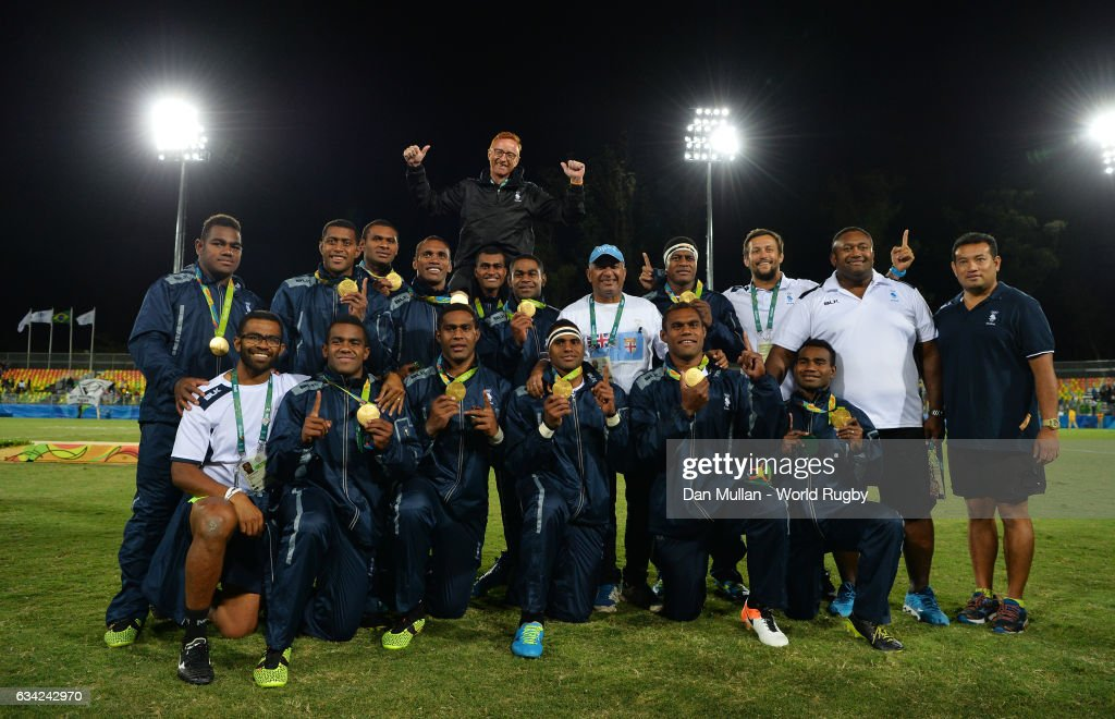 The Fiji players and staff pose following their victory during the Men's Rugby Sevens Gold Medal match between Fiji and Great Britain on day six of the Rio 2016 Olympic Games at Deodoro Stadium on August 11, 2016 in Rio de Janeiro, Brazil.