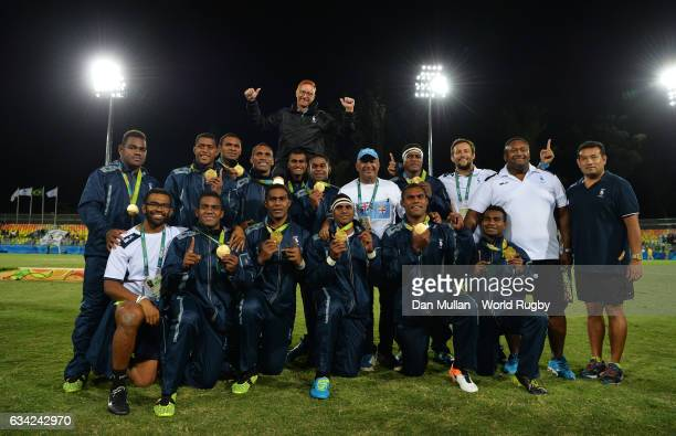 The Fiji players and staff pose following their victory during the Men's Rugby Sevens Gold Medal match between Fiji and Great Britain on day six of...