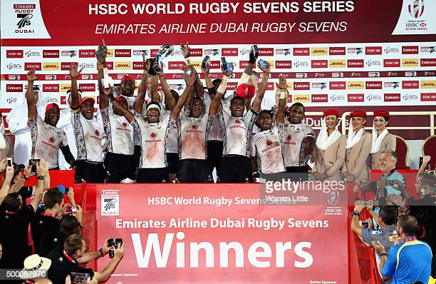 The Fiji team celebrate beating England to win the Cup Final during the Emirates Dubai Rugby Sevens HSBC World Rugby Sevens Series at The Sevens...