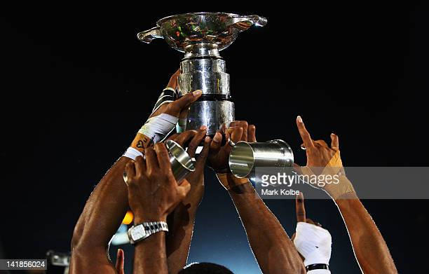 The Fiji team hold aloft the trophy as they celebrate victory in the Cup Final match between Fiji and New Zealand on day three of the 2012 IRB Hong...