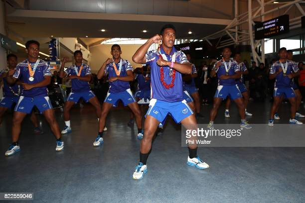 The Fijian Youth Commonwealth Games team greet their supporters with a traditional dance as they arrive back from the Bahamas Youth Commonwealth...