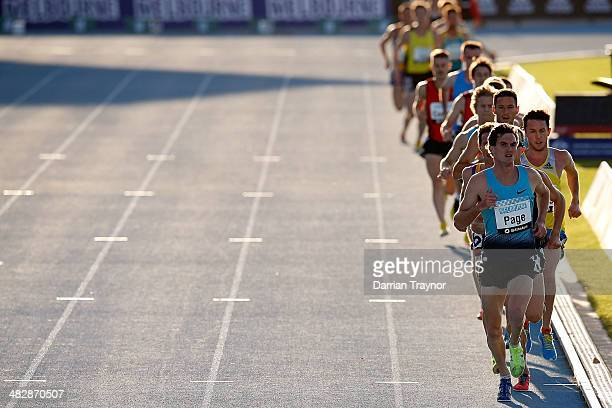 The filed of the Mens 5000m final run past the finish line during the 92nd Australian Athletics Championships at Olympic Park on April 5 2014 in...