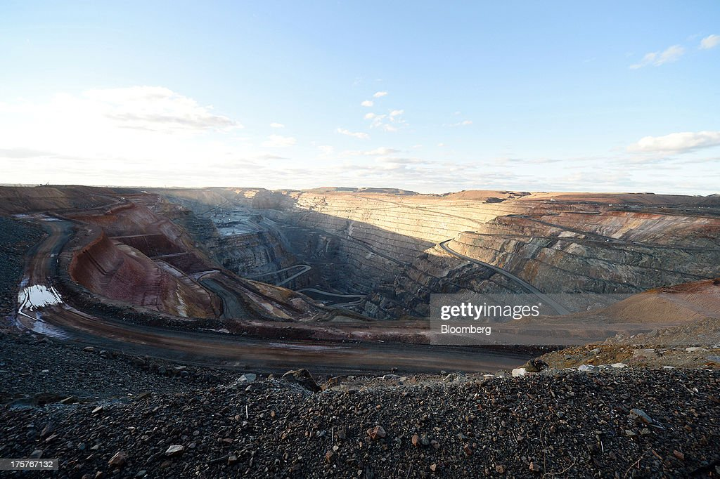 The Fimiston Open Pit, known as the Super Pit, sits in Kalgoorlie, Australia, on Monday, Aug. 5, 2013. The Super Pit is managed by Kalgoorlie Consolidated Gold Mines Ltd., jointly owned by Barrick Gold Corp., the world's largest producer of the metal, and Newmont Mining Corp., the second-largest gold producer. Photographer: Carla Gottgens/Bloomberg via Getty Images