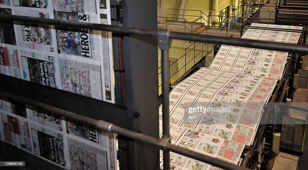 The final edition of the British tabloid newspaper News of the World rolls off the press on July 9 2011 at the News International print works in...