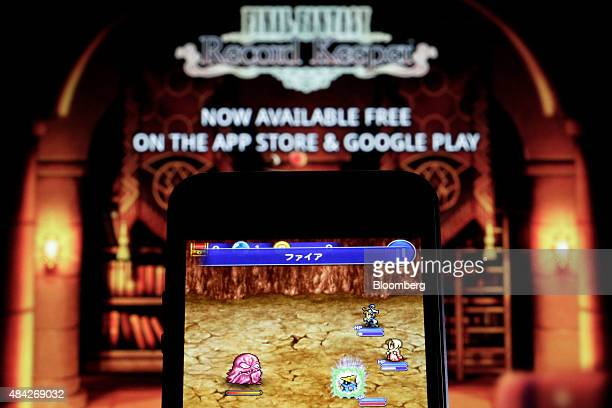 The Final Fantasy Record Keeper smartphone game codeveloped by Square Enix Co and DeNA Co is displayed on an Apple Inc iPhone 5 smartphone in front...