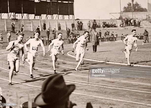 The Final of the men's 200 metres as the competitors round the curve after the first 100 metres during the Olympic Games in Paris on 9th July 1924 In...