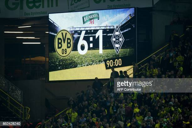 The final score is seen on the stadium display after the German First division Bundesliga football match Borussia Dortmund vs Borussia...