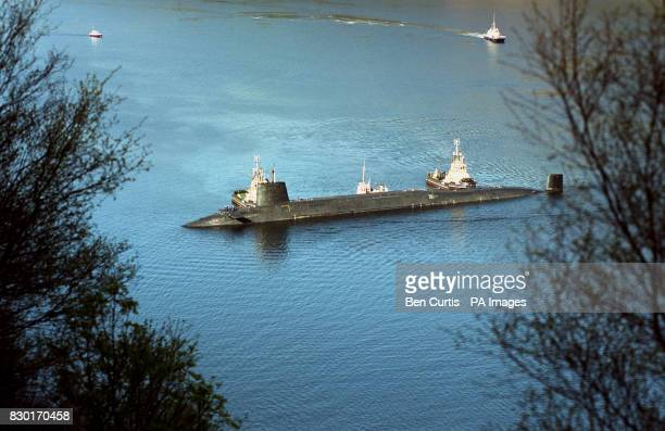 The final Trident nuclear submarine HMS Vengeance is escorted by tugboats into the naval base at Coulport Scotland Coulport is part of the Faslane...