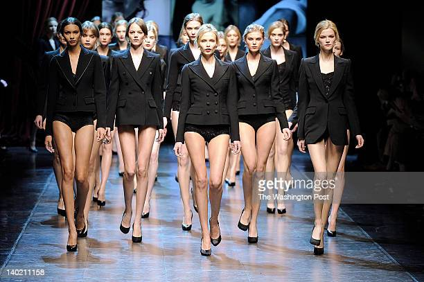The finale of the fall 2010 Dolce amp Gabbana collection with models wearing black blazers and coats over black lace briefs