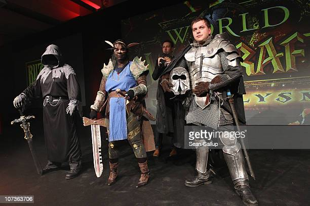 The finalists of a 'World of Warcraft' costume show stand on stage just before the new 'World of Warcraft Cataclysm' video game went on sale at the...
