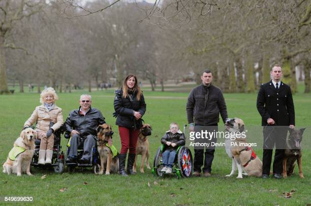 The finalists of Crufts Friends For Life Sue Harvey with Max Byron Harvey with Ziggy Tracey Marshall with Daisy Owen Howkins with his father Will...