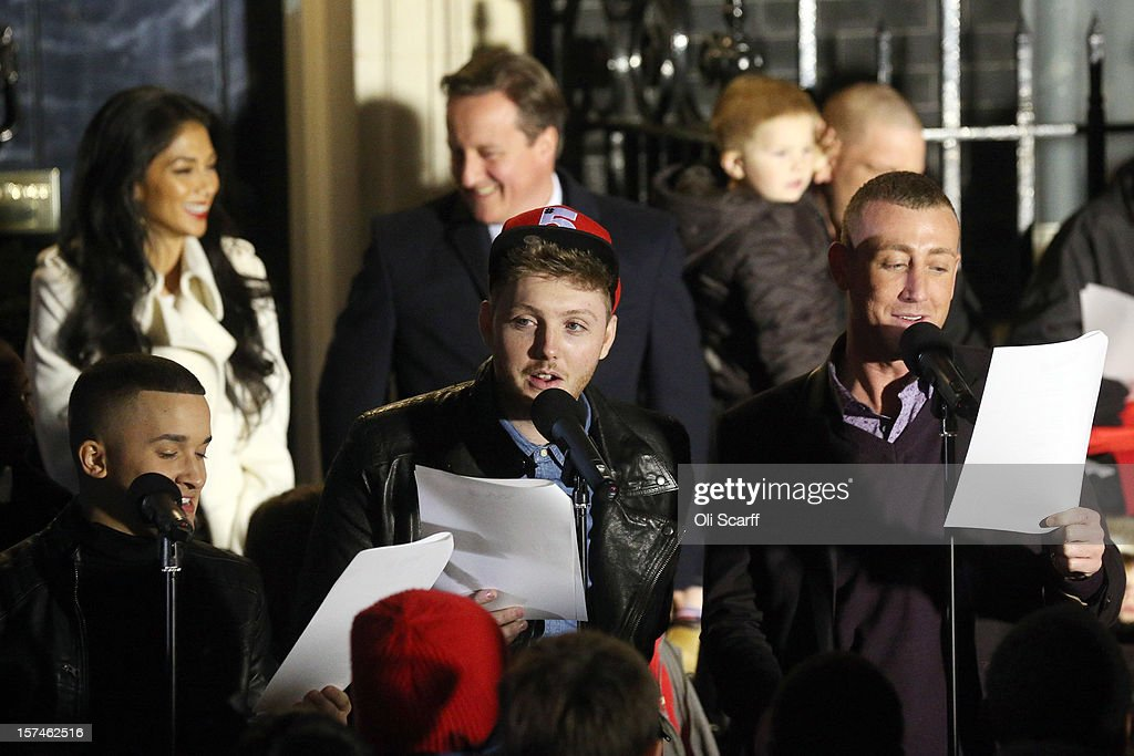 The finalists of the Xfactor programme, James Arthur (C), Jahmene Douglas (L) and Christopher Maloney ( R) sing Christmas carols at the turning on the lights of the Christmas tree outside Number 10 Downing Street on December 3, 2012 in London, England. This year's Downing Street Christmas tree was grown by Mike Craig on his farm in Dumfries, Scotland.