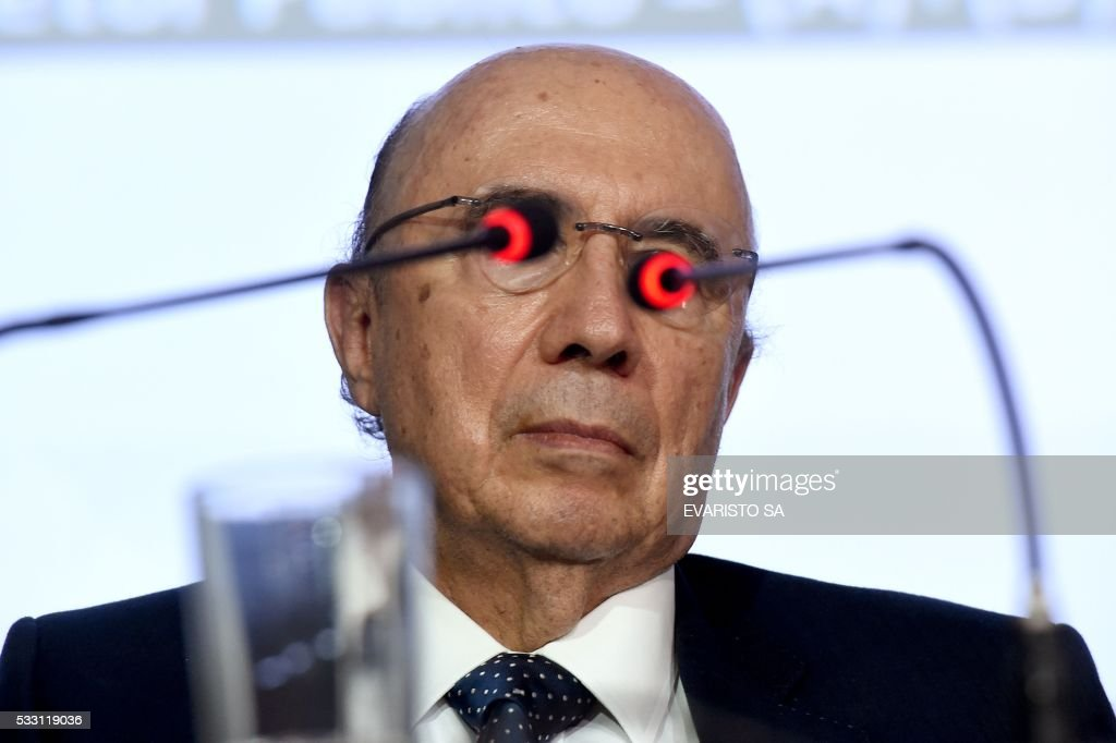 TOPSHOT The Finance Minister in Brazil's interim government Henrique Meirelles offers a press conference in Brasilia on May 20 2016 The new economic...
