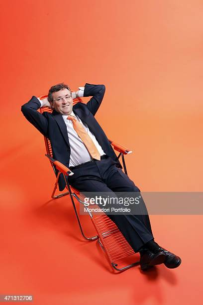 The financial director of ING Direct Alfonso Zapata in the centre of an orange room seats with his hands behind his head at the head of the Spanish...
