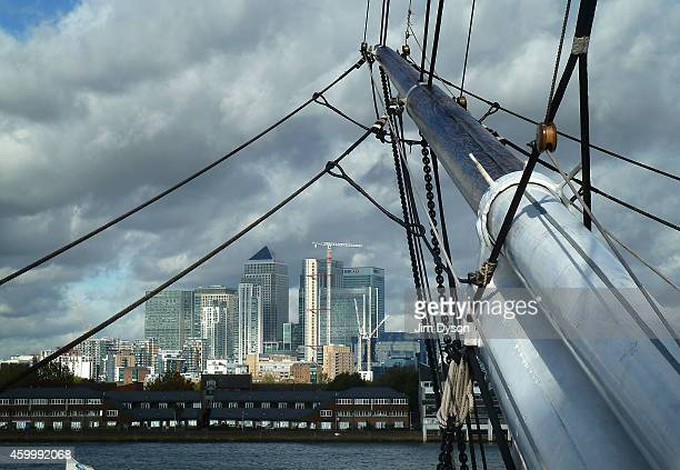 The financial district of Canary Wharf on the Isle of Dogs is seen from the prow of the tea clipper Cutty Sark in Greenwich on the River Thames on...