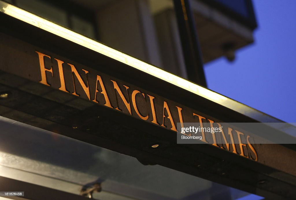 The Financial Times newspaper's signage is displayed on the publication's headquarters, as part of their 125th anniversary celebrations, in London, U.K. on Wednesday, Feb. 13, 2013. Pearson Plc, owner of the Financial Times newspaper, cut its forecast for 2012 and predicted a difficult 2013, as tougher market conditions hit earnings at its professional education and FT Group units. Photographer: Chris Ratcliffe/Bloomberg via Getty Images