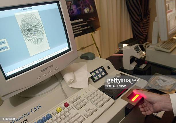 The FingerPrinter CMS device manufactured by Visionics Corporation is demonstrated October 17 2001 at the IATA's AVSEC 2001 Symposium in Atlanta GA...