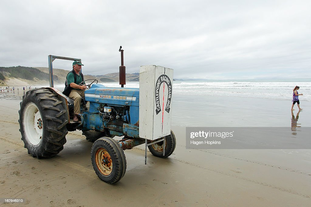The finish line is put in place during the Castlepoint Beach Races at Castlepoint Beach on March 2, 2013 in Masterton, New Zealand.