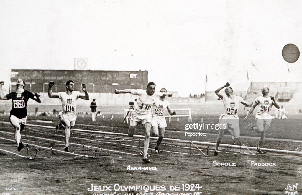 The finish of the final of the Men's 100 Metres at the 1924 Olympic Games, Paris, 7th July 1924. Harold Abrahams (1899 – 1987) of Great Britain's breaks the tape to win the gold medal, followed by Jackson Scholz (1897 – 1986) of the USA for silver and Arthur Porritt (1900 - 1994) of New Zealand, who took bronze.