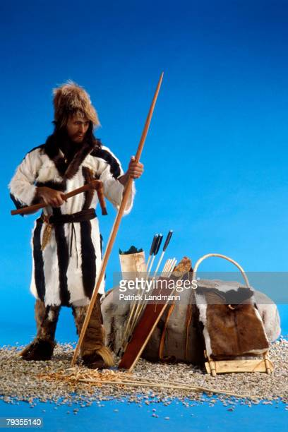 The finished display version of iceman Otzi with a bearskin hat goatskin coat and leggings and leather sandals filled with straw on October 1 1997 in...