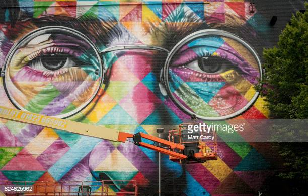 The finishing touches are made to a portrait of John Lennon by the Brazilian artist Eduardo Kobra on the final day of 'Upfest' Europe's largest...