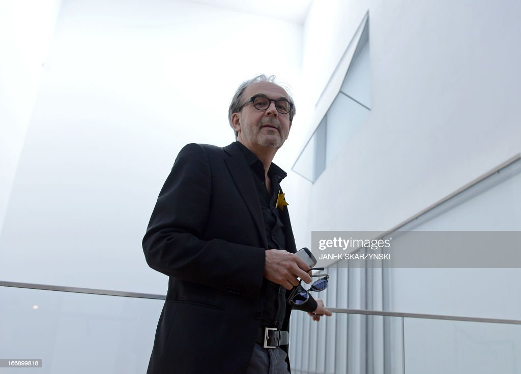 The Finnish architect Rainer Mahlamaeki poses for a photographer inside the Museum of the History of Polish Jews designed by him, on April 18, 2013 In Warsaw.