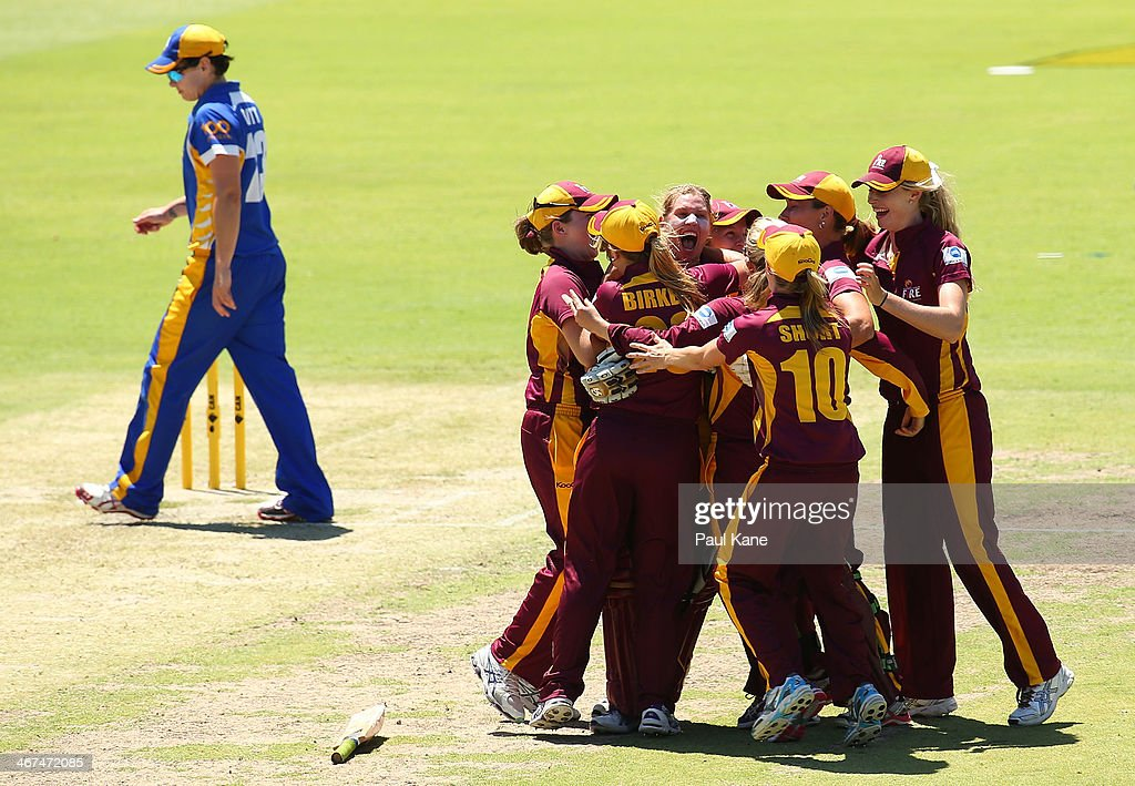 The Fire celebrate after winning the WT20 Final match between the Queensland Fire and the ACT Meteors at WACA on February 7 2014 in Perth Australia