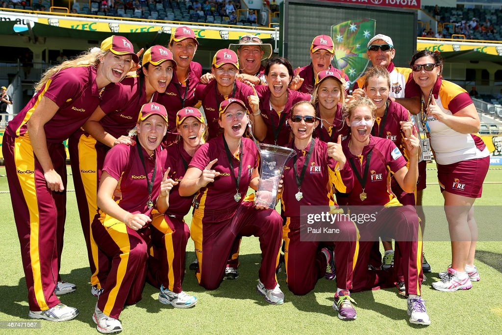 The Fire celebrate with the trophy after winning the WT20 Final match between Queensland Fire and the ACT Meteors at WACA on February 7 2014 in Perth...