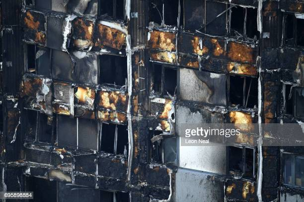 The fire damaged lower floors of the 24 storey residential Grenfell Tower block in Latimer Road West London on June 14 2017 in London England The...